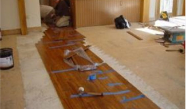 Can laminate flooring be installed over tile